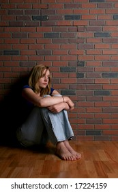 woman sitting alone depicting mental health concept of depression