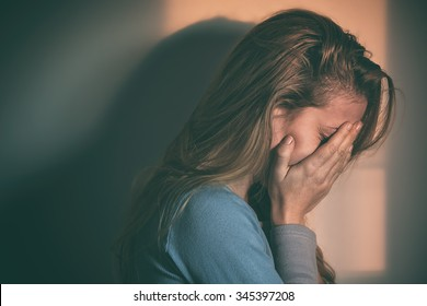 A woman sitting alone and depressed