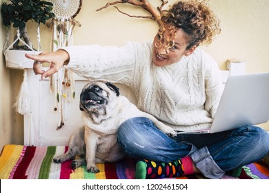woman sitting in the balcony with her friend pug spend time cuddling. Friendship and technology concept for animal lover and alternative office wolutions to make happy modern business with internet