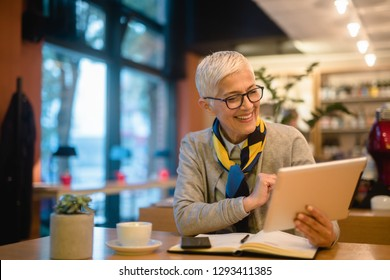 Woman is sitting in a cafe during the morning
