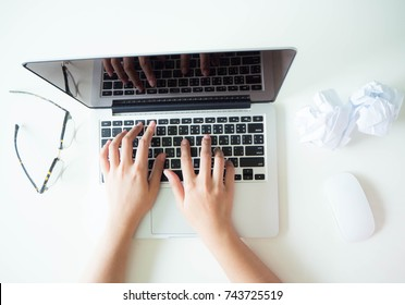 Woman sitting at desk and working at computer hands close up. Homeoffice