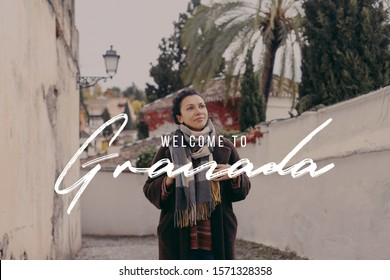A woman sitting and enjoying the view of Granada town and mountains Sierra Nevada, Spain with text written in English 'Welcome to Granada '