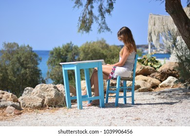The woman sitting in the fisherman's bar