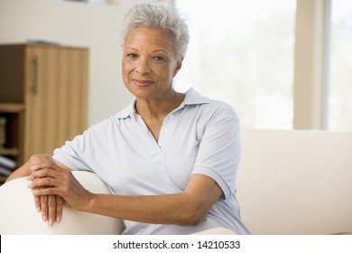 Woman sitting in living room