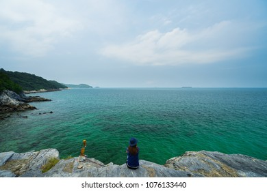 Woman are sitting and looking at ocean