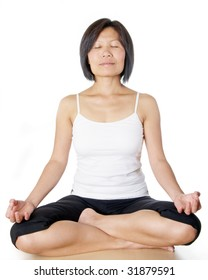 Woman sitting in the lotus pose