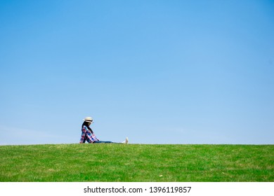 Woman sitting in the meadow