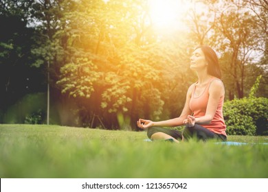 woman sitting and meditates while practicing yoga. Calmness and relax, woman happiness concept.