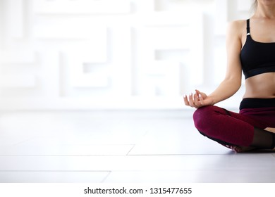Woman sitting of meditation in the lotus position close-up. Yoga.