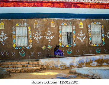 A woman sitting next to her house, Nuba,, Aswan, southern Egypt, August 2014