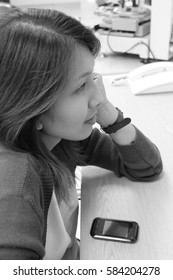 A woman sitting in the office. Have due diligence, Working women,Work with happiness ,B/W