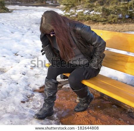 Woman Sitting On Bench Hunched Over Stock Photo Edit Now 182644808