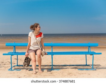 Woman sitting on bench and looking away.