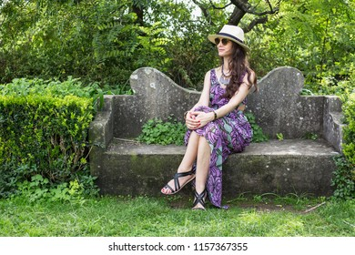 Woman sitting on the bench in park in Lisbon city, Portugal