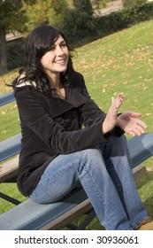 Woman sitting on bleachers