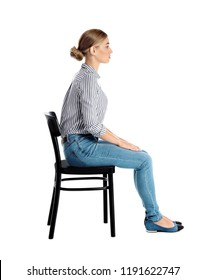 Woman sitting on chair against white background. Posture concept