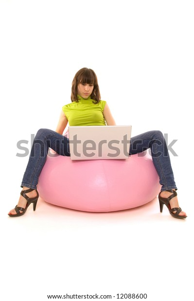 woman sitting on comfortable chair and looking to the laptop