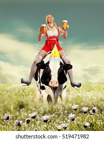 Woman sitting on a cow and holding a big glass of beer in her hands