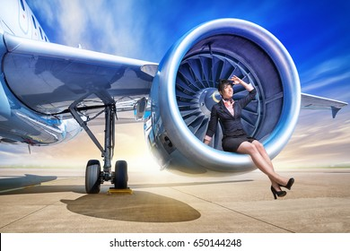 woman sitting on a engine of an airplane