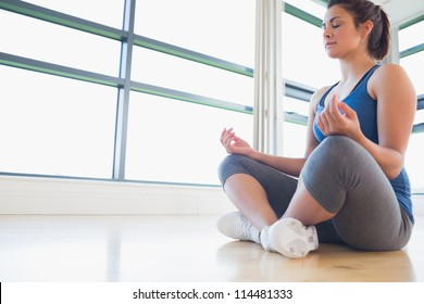Woman sitting on the floor medtiating