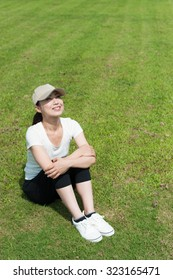Woman sitting on the grass