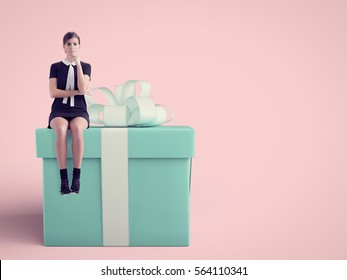 woman sitting on huge present in studio