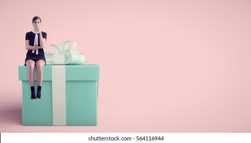woman sitting on huge present in studio