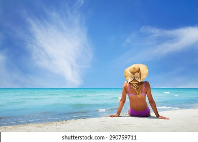 woman sitting on paradise beach