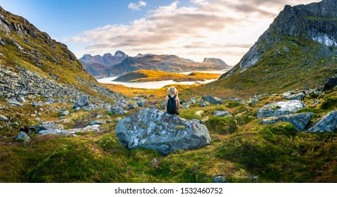 woman sitting on rock with beautiful nature