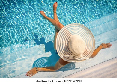 woman sitting on the stairs of a luxury five stars  spa resort  swimming pool.