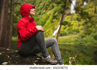 Woman sitting on a stone and enjoying the nature