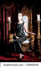 Woman sitting on throne