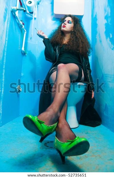 Woman Sitting On Toilet Bowl Neglected Stock Photo