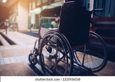 Woman sitting on wheel chair at hospital in the night