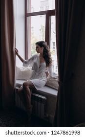Woman sitting on the window