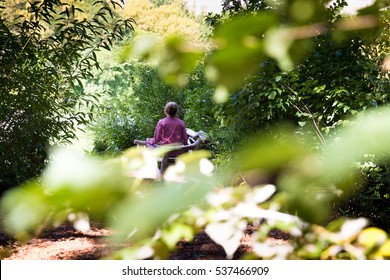 Woman sitting in the park meditating