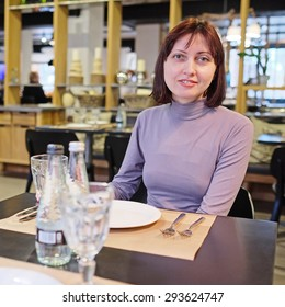 Woman sitting in the restaurant
