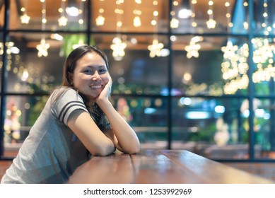 Woman sitting sadly in a coffee shop.