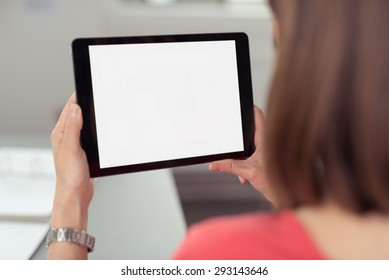 Woman sitting and using a black wireless tablet PC with white blank touch screen or interface, rear