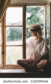 Woman sitting at window