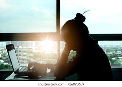Woman sitting work computer stressed not happy at her desk . Health concept