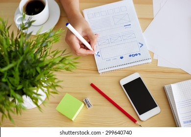Woman sketching on paper web design