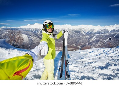 Woman with ski pull friend holding hand