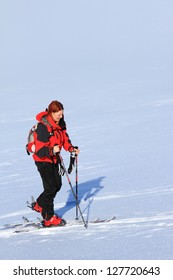 Woman ski touring in Tarcu mountains, Romania