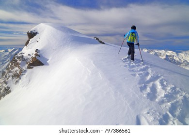 Woman skier on fresh snow , Les Deux Alpes, France