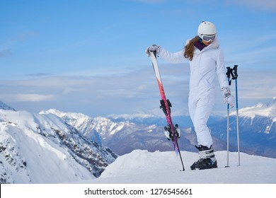 woman skier  wearing white healmet with mask in snow winter mountain
