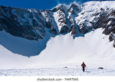woman skiing to base of landry chutes on the north face of east mt sopris, an extreme ski descent in colorado