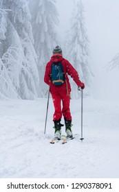 Woman skiing on fresh powder snow. Ski in winter season, mountains and ski touring backcountry equipments on the top of snowy mountains. Beskidy, Carpathian mountain range, Poland