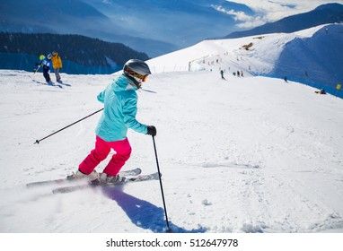 Woman skiing on a snowy road in the mountains