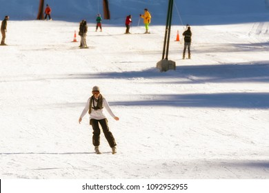 Woman skiing at a snow ski center in Greece.